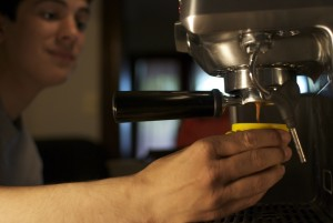 Pulling the first shot - Prepare the espresso (step 1 of how to make cappuccino at home)