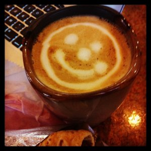 Enjoying a #smile latte after another good Coach Cafe (coffee serendipity)