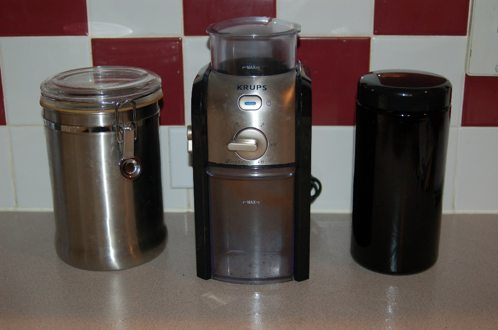 Left to right (my old coffee jar, my Krups Burr Grinder, the Infinity coffee jar)